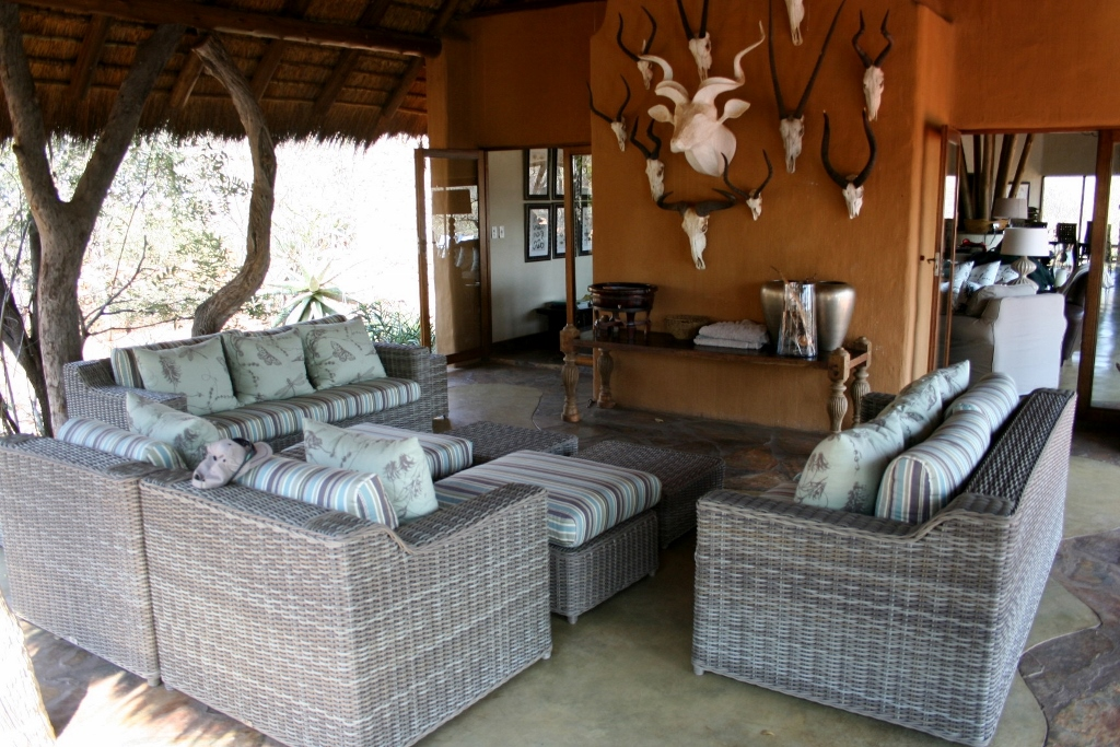 Main Kukama lodge outdoor sitting area with animal wall mural